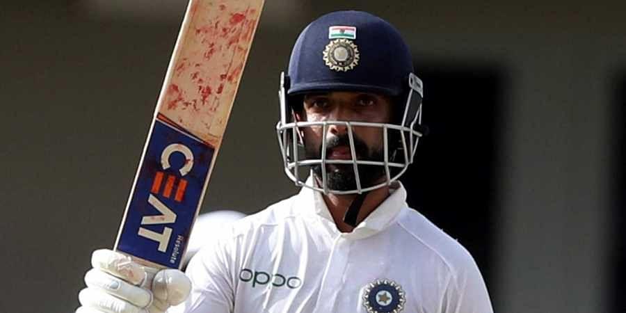 India's Ajinkya Rahane celebrates scoring half a century against West Indies during day three of the first Test cricket match at the Sir Vivian Richards cricket ground in North Sound.