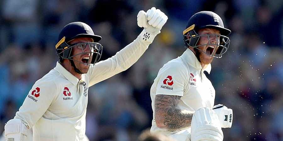 England's Jack Leach and Ben Stokes, right, celebrate victory on day four of the third Ashes cricket Test match against Australia at Headingley.