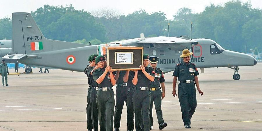 Jawans shoulder the mortal remains of Gorkha Rifles jawan, Rajib Thapa at AFS Palam, in New Delhi on Saturday. Thapa lost his life in ceasefire violation by Pakistan in Naushera sector of Jammu and Kashmir on Friday.