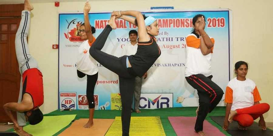 Participants of the National Yoga Championship performing yoga asanas at the competition held by Yoga Bharati Trust at KSR complex Sethammadhara in Visakhapatnam on Saturday