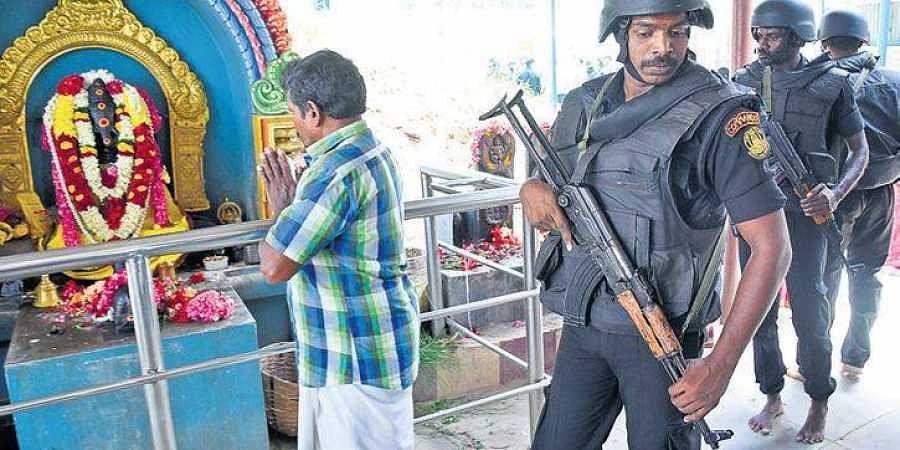 Police commandos at Kovai's Ukkadam Lakshmi Narasimhar Temple