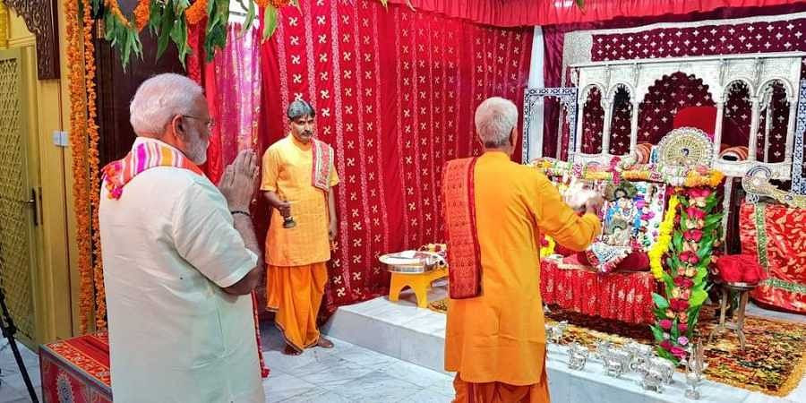 Prime Minister Narendra Modi offering prayers at Shreenathji Temple in Manama on Sunday.