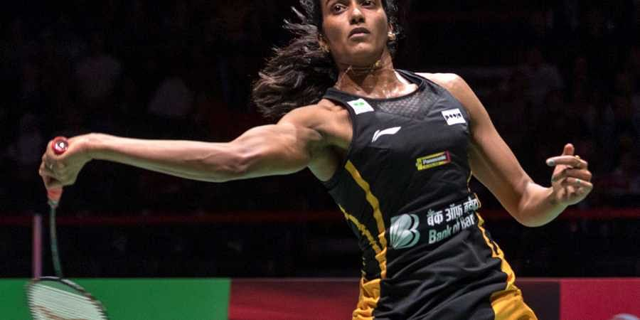 PV Sindhu returns a shuttlecock to Japan's Nozomi Okuhara during their women's singles final match at the BWF Badminton World Championships in Basel.