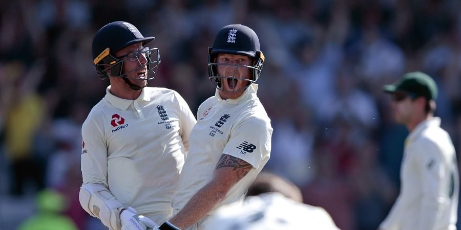England's Ben Stokes, center, with Jack Leach celebrates after scoring the winning runs on the fourth day of the 3rd Ashes Test. (Photo | AP)