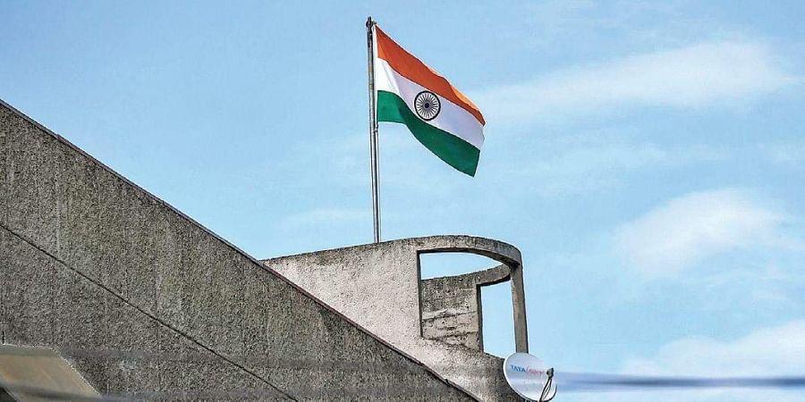 The Indian national flag flutters atop Civil Secretariat in Srinagar.