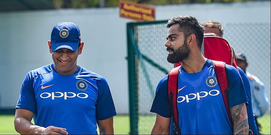 Virat Kohli and MS Dhoni (L) during a practice session ahead of the 2nd ODI cricket match against Australia at Vidarbha Cricket Association Stadium in Nagpur.