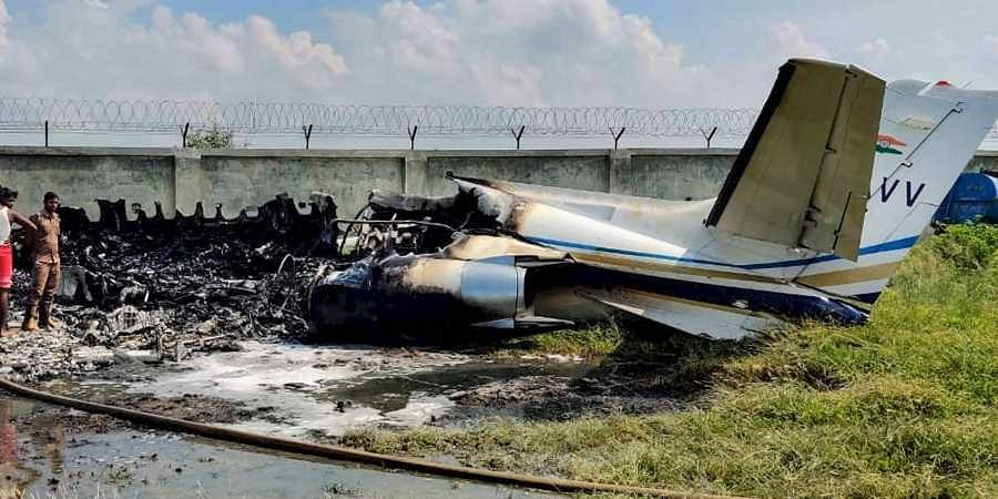 The wreckage of a trainer aircraft VT-AVV which crashed during a landing attempt at Aligarh Dhanipur airstrip in Uttar Pradesh Tuesday