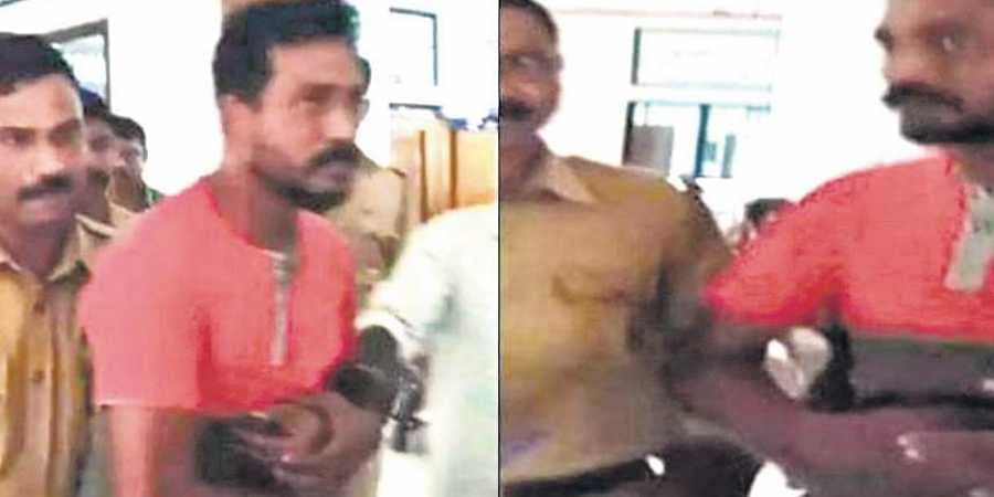 Police taking Abdul Khader Raheem,39, of Kolliyil, a native of Kodungalloor, in Thrissur into custody in connection with a terror case