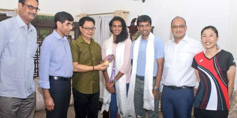Sports Minister Kiren Rijiju on Tuesday presented a Rs 10 lakh cheque to PV Sindhu for her historic triumph at the World Championships in Basel, Switzerland.