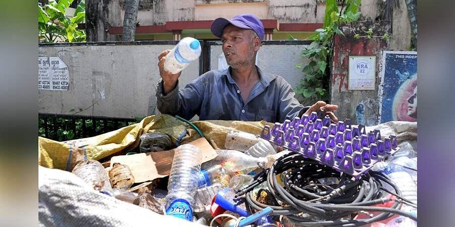 Aminul, a rag picker from Moorshidabad, Kolkata, collecting scraps in Kochi