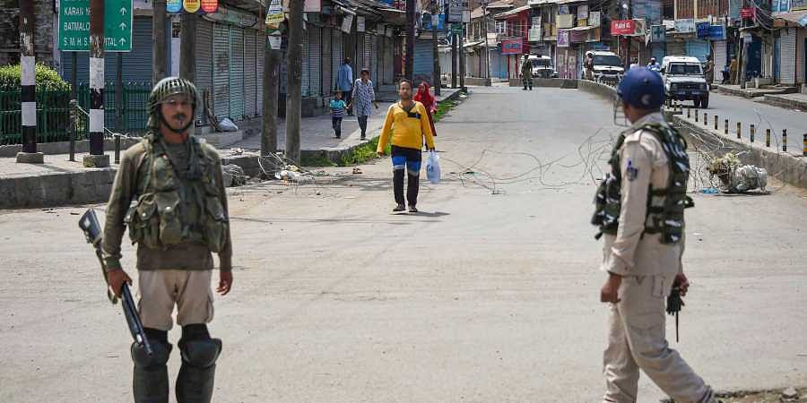 Security personnel stand guard at a check point during restrictions after Centre abrogated Article 370 and divided Jammu and Kashmir into two union territories in Srinagar Sunday August 18 2019.