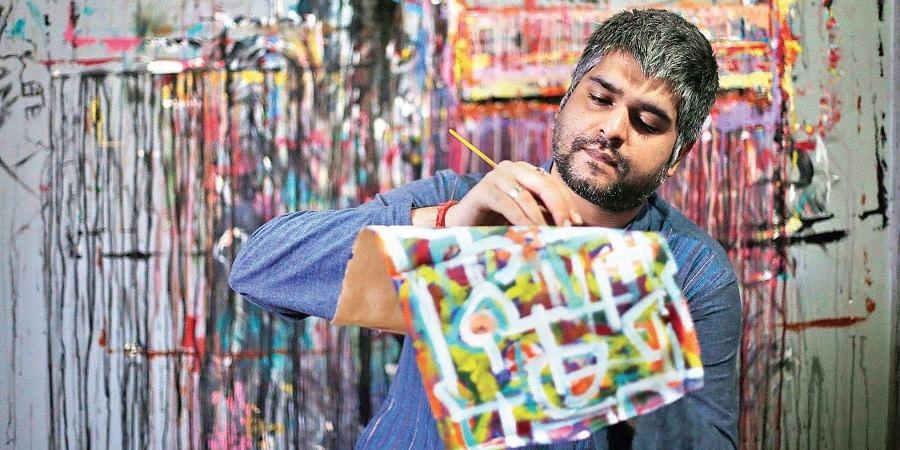 Pallav Chander creating art his studio.