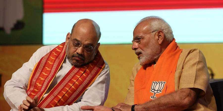 BJP chief Amit Shah (L) and PM Narendra Modi (File | EPS)