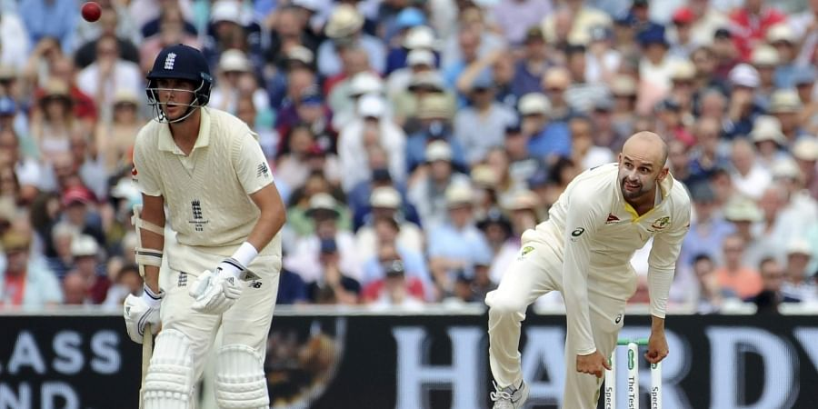 Australia's Nathan Lyon, right, bowls during day three of the first Ashes Test cricket match between England and Australia at Edgbaston in Birmingham.
