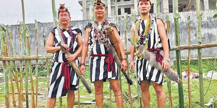 Nyishi men in traditional attire.