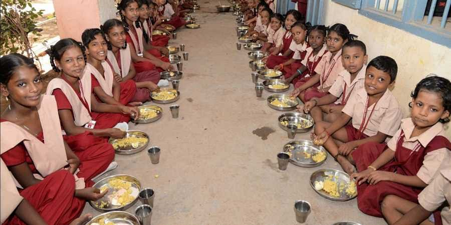 Midday meals being served to children aged between 6-14 years of age.