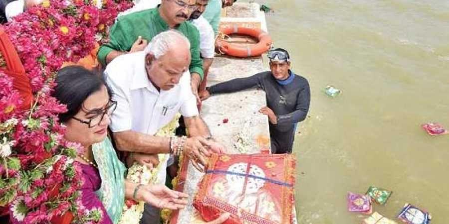 Chief Minister BS Yediyurappa and Mandya MP Sumalatha Ambareesh offers bagina at KRS dam in Mandya district on Thursday