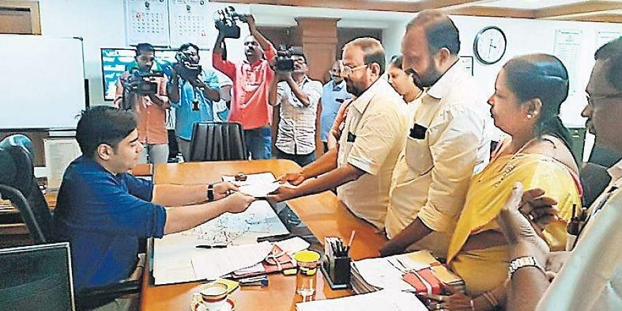 Kochi Corporation Opposition leader K J Antony gives a letter signed by 34 LDF councillors to District Collector S Suhas seeking a no-confidence motion against Mayor Soumini Jain