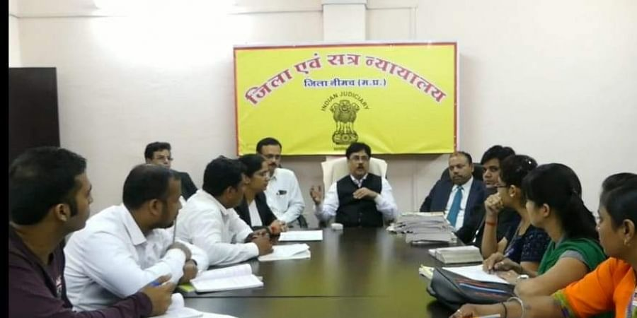 District and Sessions Judge Hridyesh Srivastava teaching judicial service aspirants youngsters at Neemuch District Court