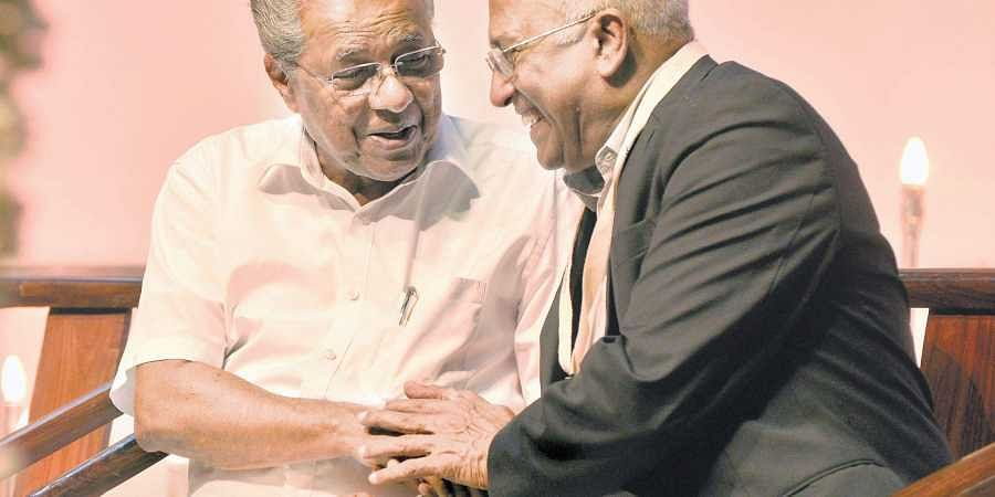 Chief Minister Pinarayi Vijayan sharing a light moment with astronaut Rakesh Sharma at the SPACE Fest programme organised by the DC Kizhakeemuri Foundation and DC School of Architecture and Design at Kanakakkunnu Palace in Thiruvananthapuram on Thursday