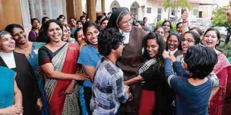 Students of St Teresa's College celebrate with director Sr Vineetha after the institution was awarded A++ grade by NAAC