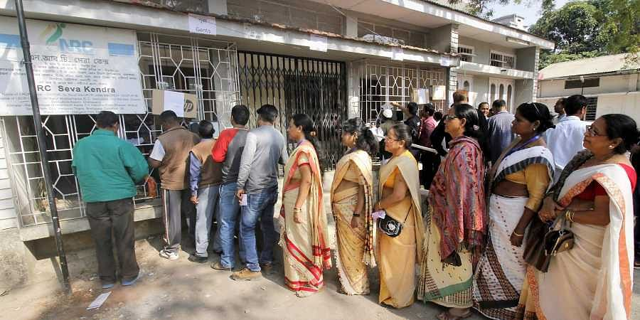 People queue outside NRC Seva Kendra to check names of themselves and family members in a draft for NRC in Guwahati.