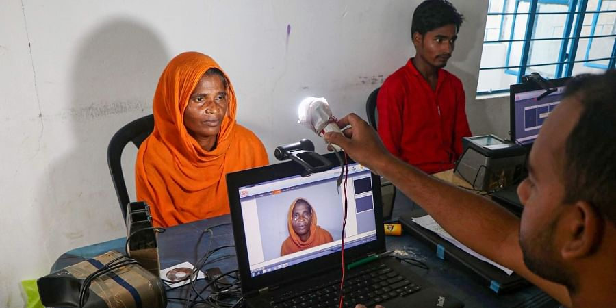 An official takes photo of an applicant to submit her bio-metrics data ahead of NRC final draft publication at Hatipara village in Kamrup Friday August 30 2019. | PTI