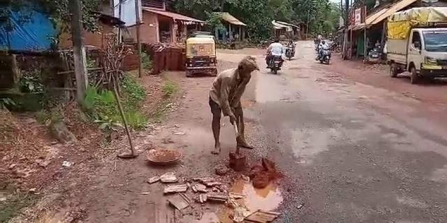 Parameshwara Gouda, has been filling potholes near Harodi village for the last four years.