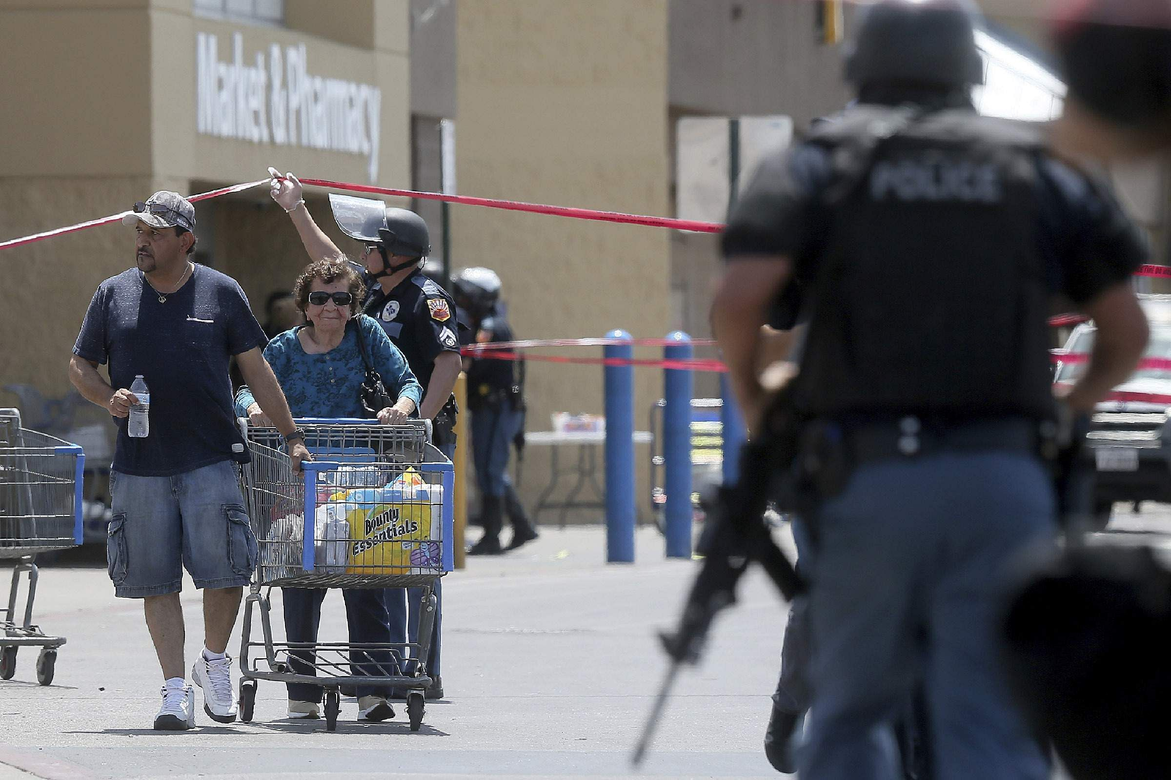 Walmart customers are escorted from the store after a gunman opened fire on shoppers near the Cielo Vista Mall in Texas.