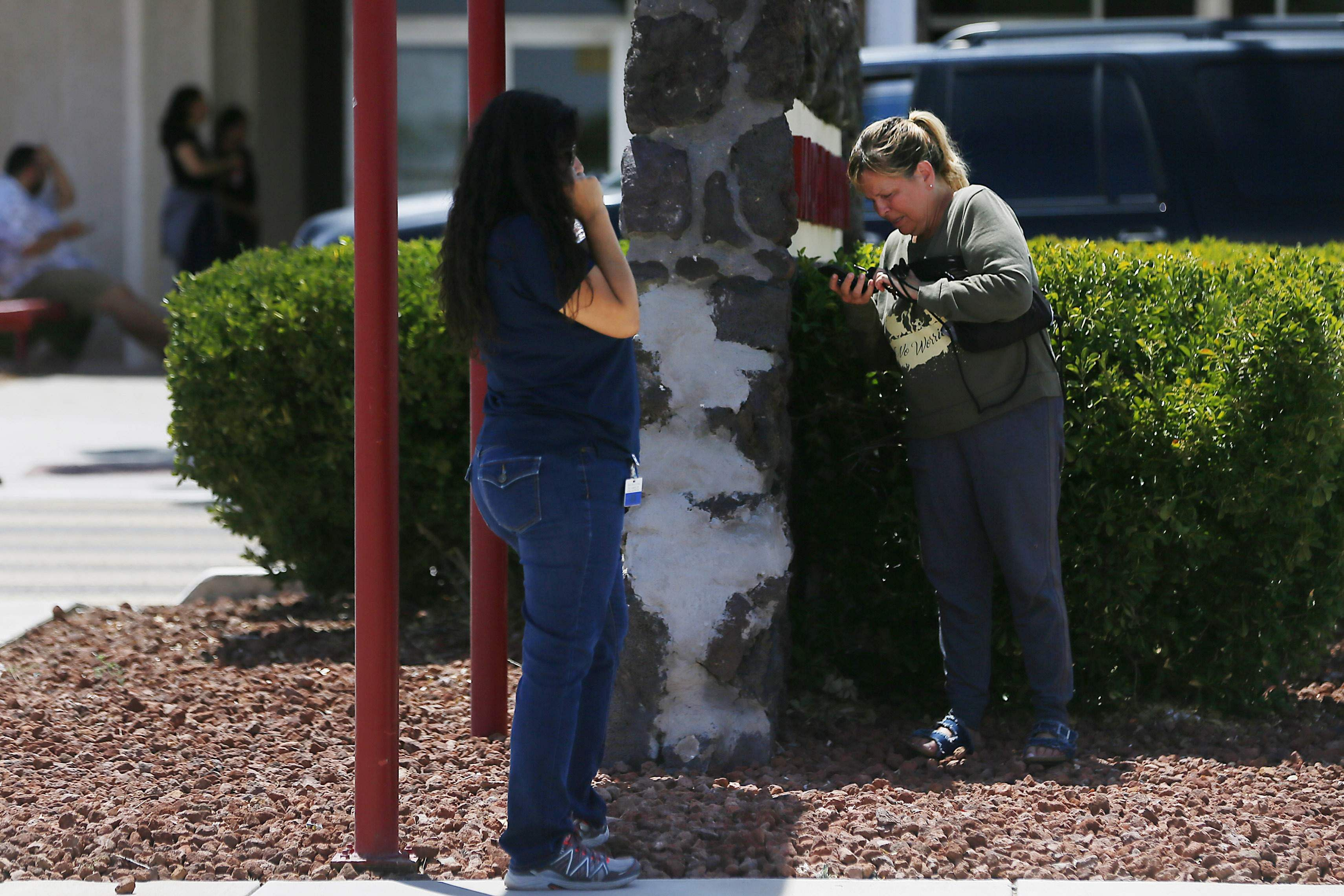People arrive at MacArthur Elementary looking for family and friends as the school is being used a re-unification center during the aftermath of a shooting at a Walmart near the Cielo Vista Mall in Texas.
