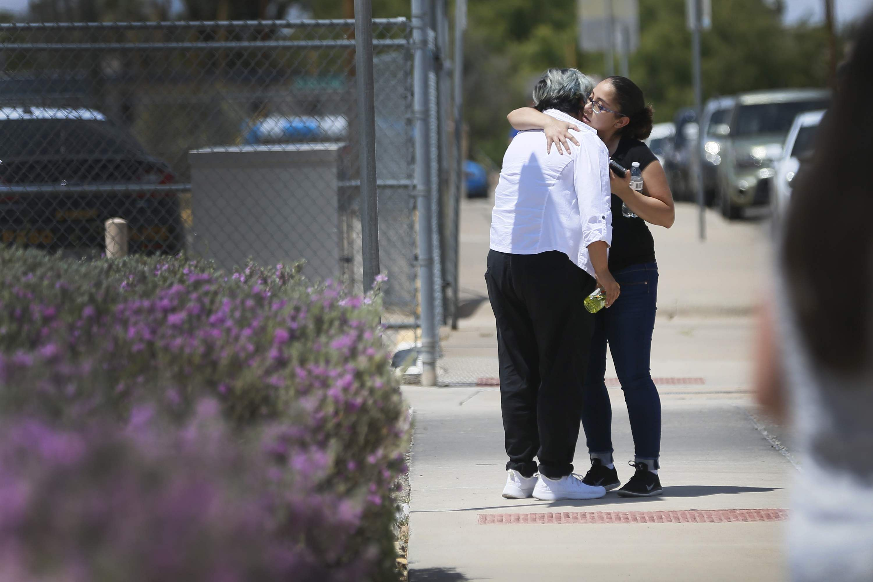 People arrive at MacArthur Elementary looking for family and friends as the school is being used a re-unification center during the aftermath of a shooting at a shopping mall in Texas.