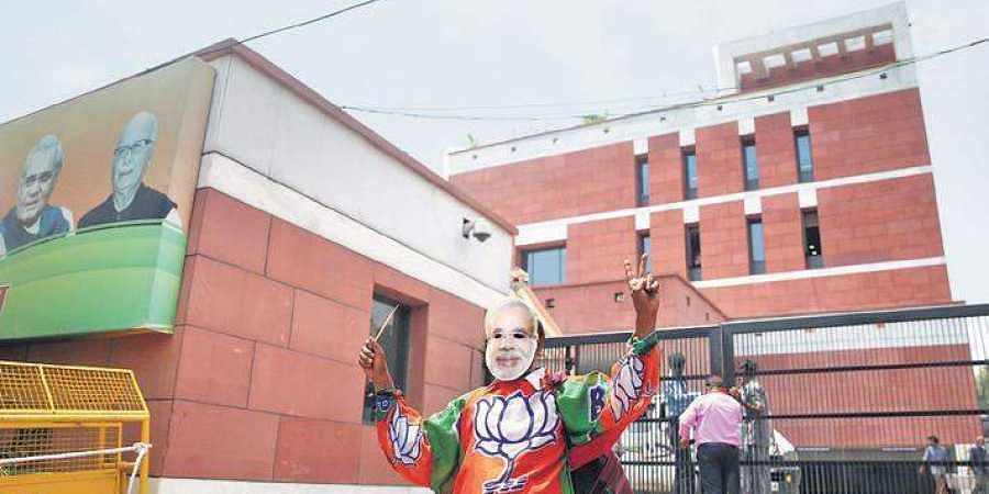 A BJP supporter infront of the party's heaquarters in the national capital