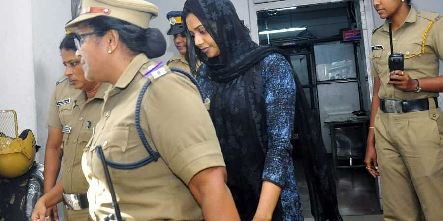 Police take Wafa Firoz after recording her statement in connection with the drunk driving accident that killed a journalist near Museum junction on Saturday.