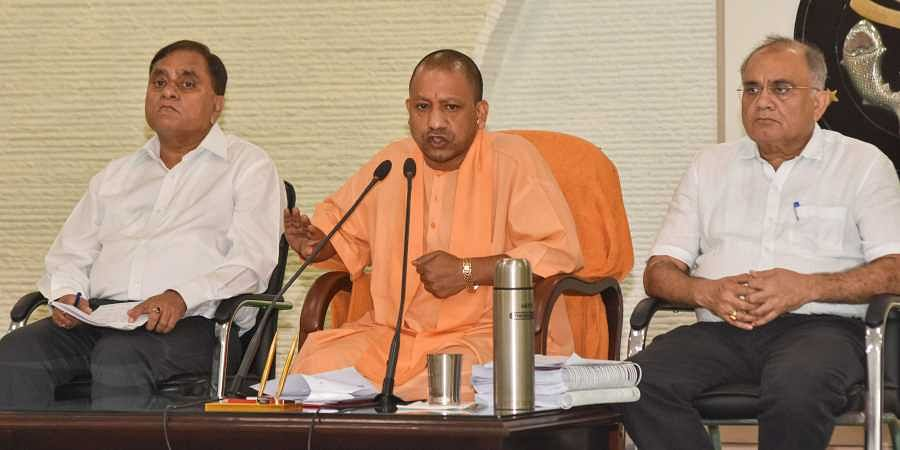 Uttar Pradesh Chief Minister Yogi Adityanath addresses a press conference at his residence in Lucknow on Aug 4 2019. Also seen are UP DGP OP Singh and Chief Secretary Anoop Kumar Pandey. (Photo | PTI)