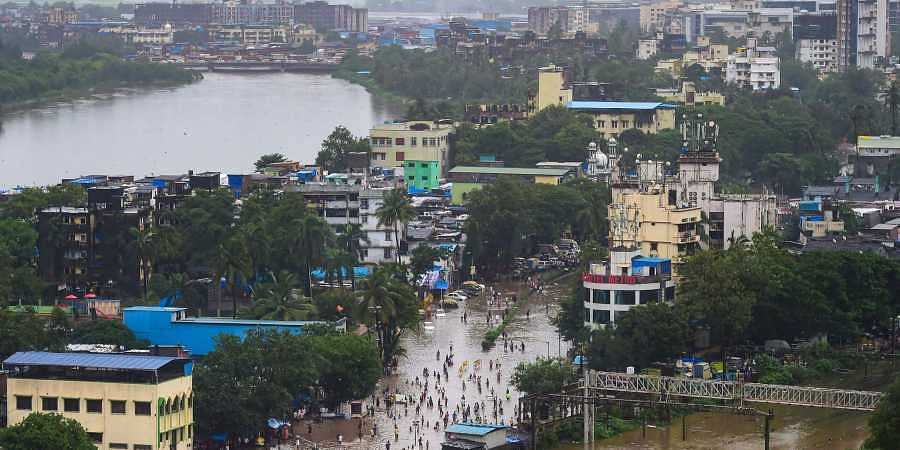 A view of the waterlogged tracks and between Sion and Kurla and surrounding areas after the water level of Mithi river rose due to incessant monsoon rains in Mumbai, Aug. 4 2019. (Photo | PTI)