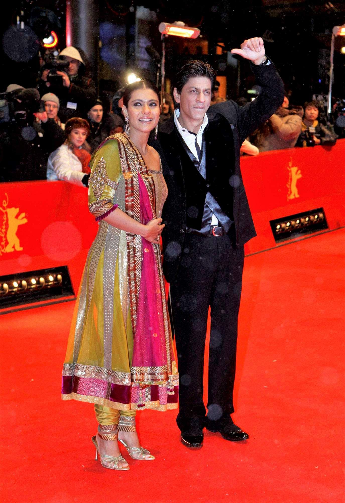 Bollywood actors Shah Rukh Khan (R) and Kajol arrive at the premiere for the 'My Name Is Khan' at the International Film Festival Berlinale in Berlin, Germany.