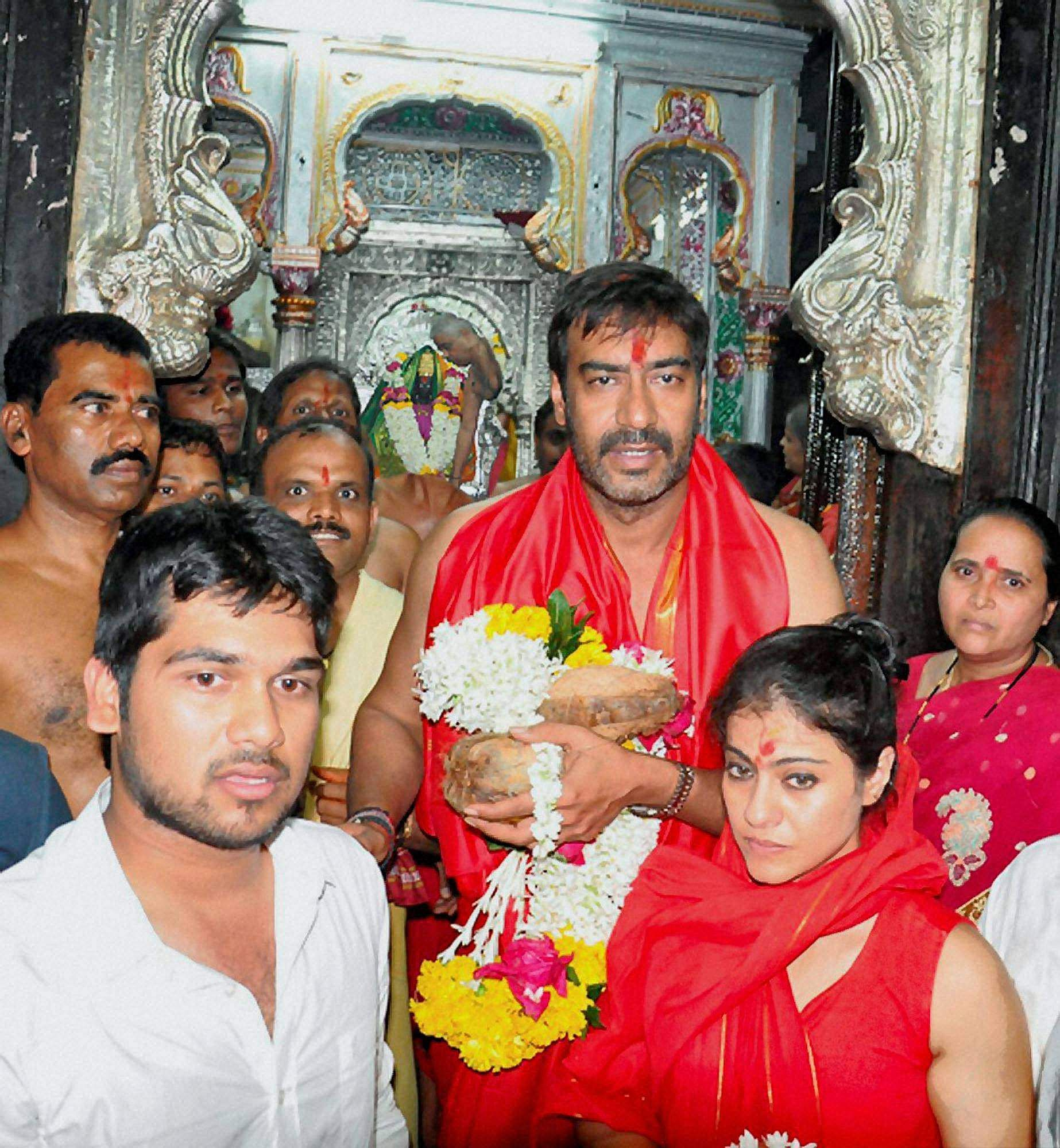 Bollywood actor Ajay Devgn along with his wife actress Kajol performing worship at Mahalaxmi temple for the success of the film Son of Sardar in Maharashtra.