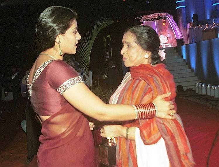 Kajol congratulating Asha Bhosale for the best female play back singer for the film Laggan at the 8th annual Asian Paints Star Screen Weekly Awards for excellence in cinema at Andheri Sports Comple.