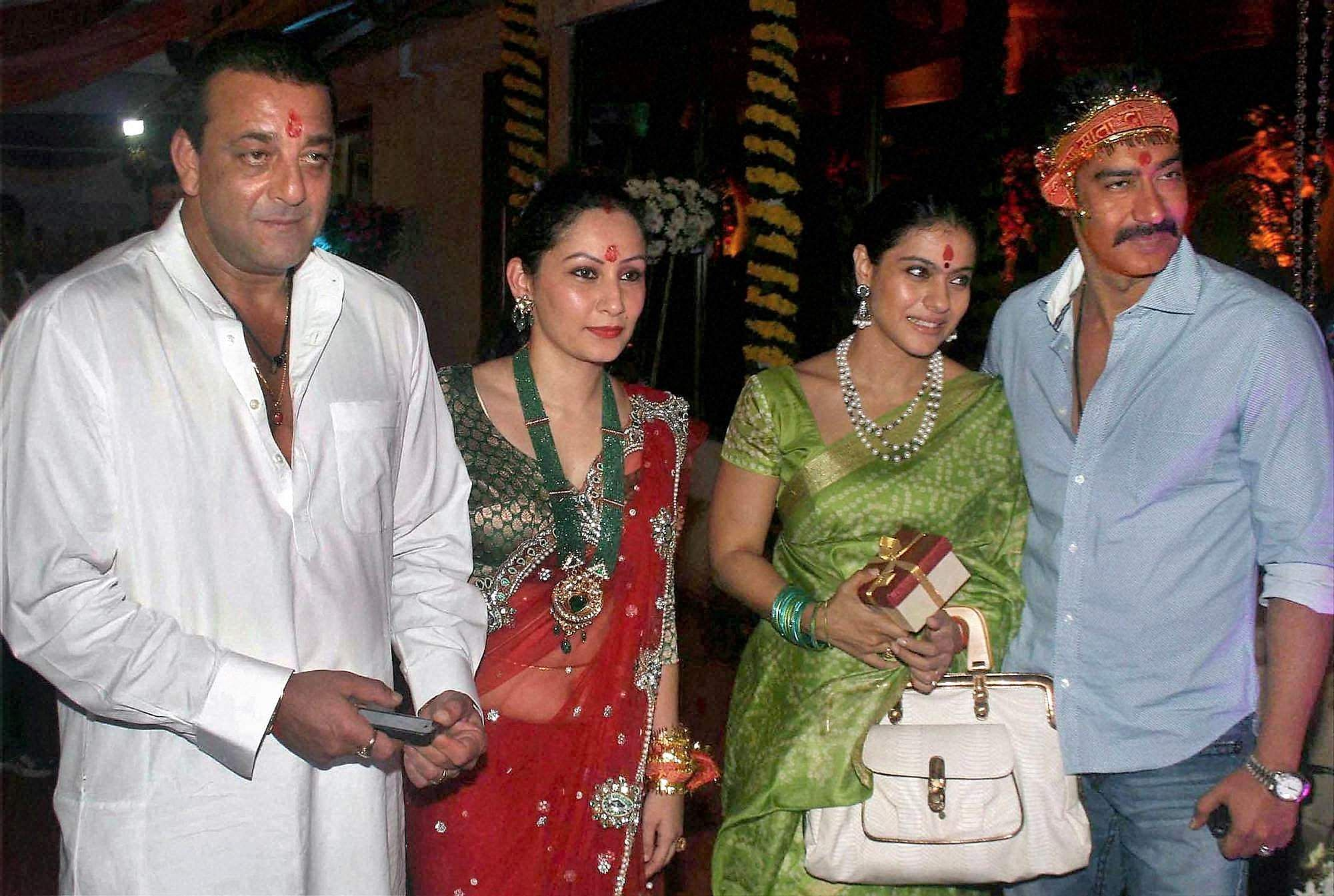 Bollywood actor Sanjay Dutt, his wife Manyata, actress Kajol and her husband Ajay Devgan at the Mata Ki Chowki at Dutts residence in Mumbai.