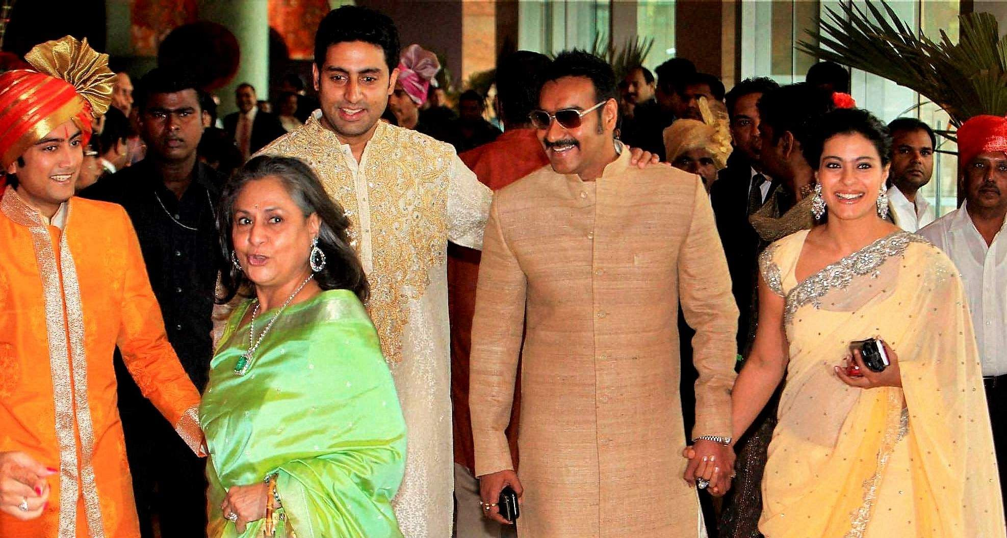 Bollywood actors Jaya Bachchan, Abhishek Bachchan, Ajay Devgan and Kajol arrive to attend the wedding of actor Ritesh Deshmukh with Genelia D'Souza in Mumbai.