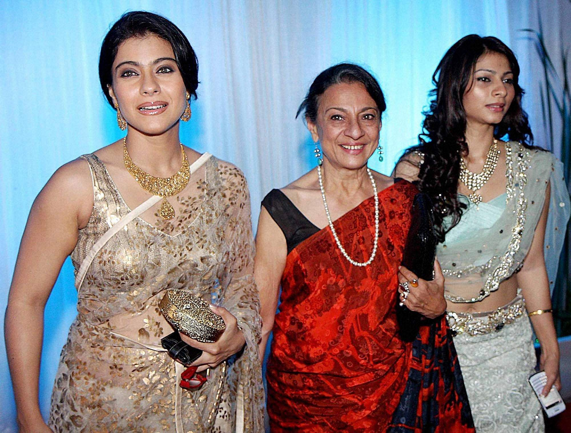 Bollywood actress Tanuja with her daughters Kajol and Tanisha pose for the photographers during the wedding reception of Esha Deol and Bharat Takhtani in Mumbai.