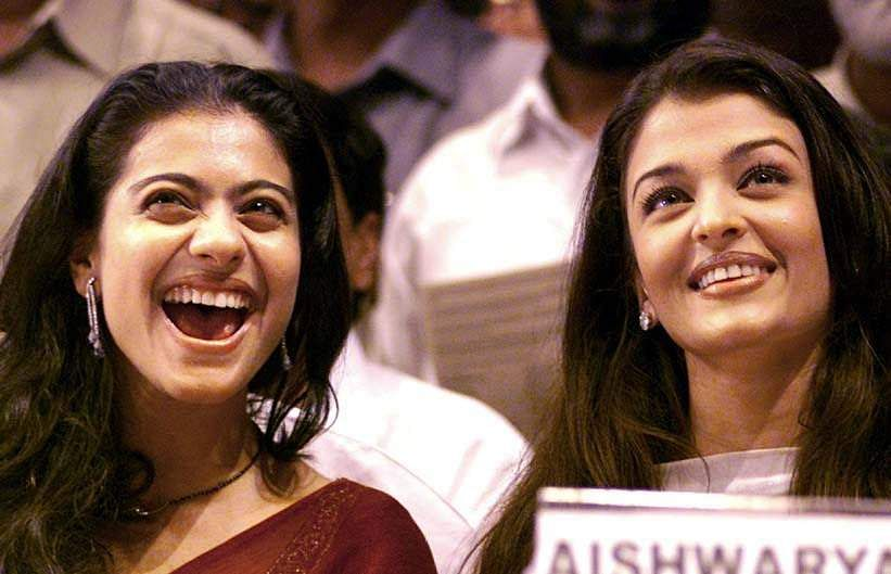 Bollywood star Kajol (L) laughs as former Miss World and actress Aishwarya Rai looks on in Mumbai. The stars received special awards on the birth anniversary of slain former Prime Minisiter Rajiv Gandhi.