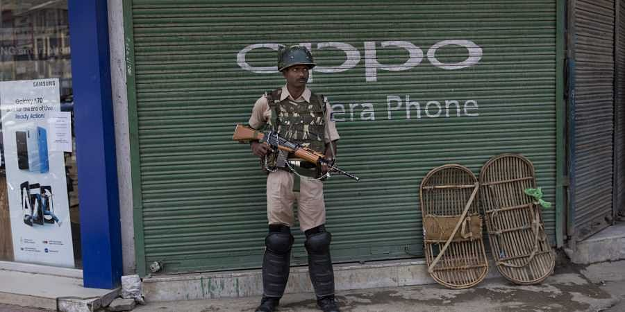 An Indian paramilitary soldier stands guard in Srinagar, Kashmir.