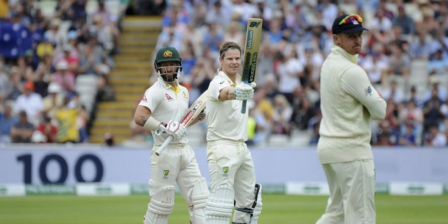 Australia's Steven Smith, centre, celebrates scoring a century during day four of the first Ashes Test cricket match between England and Australia at Edgbaston in Birmingham. (Photo | AP)