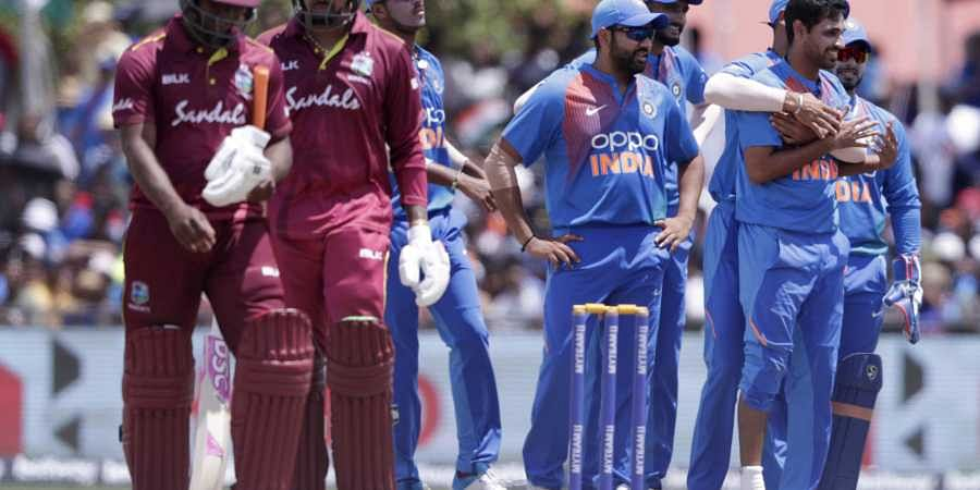 India's Bhuvneshwar Kumar, right, is congratulated after taking the wicket of West Indies' Evin Lewis, left, during the second Twenty20 international cricket match. (Photo | AP)