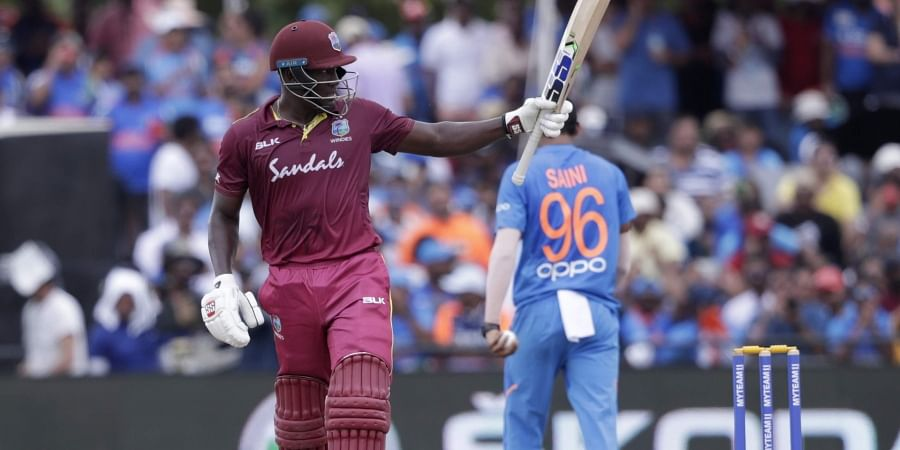 West Indies' Rovman Powell raises his bat after scoring fifty runs during the second Twenty20 international cricket match against India. (Photo | AP)