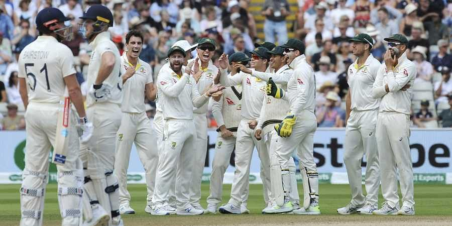 Australia players celebrate after a review confirms the dismissal of England's Jonny Bairstow during day five of the first Ashes Test cricket match between England and Australia at Edgbaston in Birmingham. (Photo | AP)