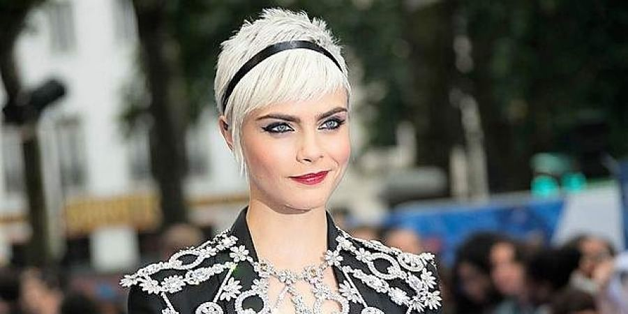 Cara Delevingne marries girlfriend Ashley Benson in secret ceremony