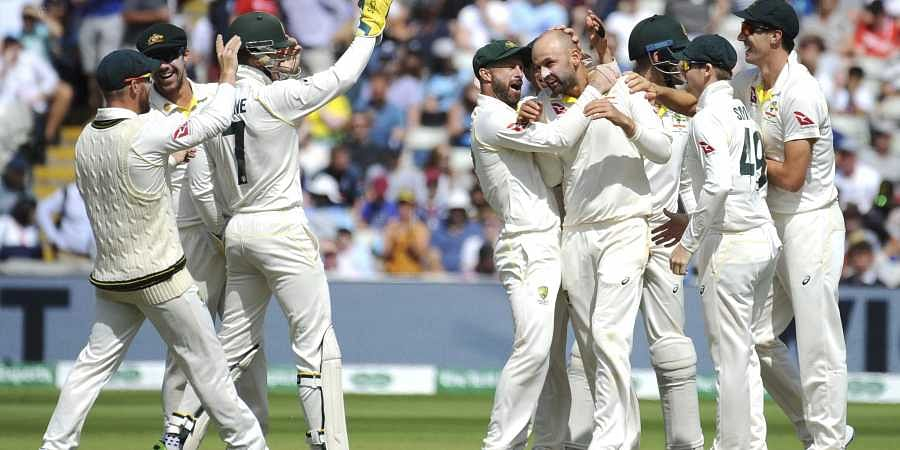 Australia's Nathan Lyon, centre right, celebrates with teammates after dismissing England's Jason Roy. (Photo | AP)