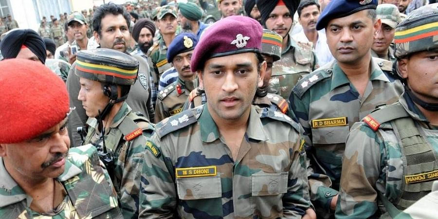 MS Dhoni (C), former Indian cricket team captain and honourary Lieutenant Colonel in the Indian Territorial Army, walks with military officers at the Army headquarters in Baramulla, north of Srinagar. (Photo | AFP)